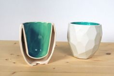 Instead of a smooth design, this porcelain mug is made up of polygons. The bright inside of the mug contrasts the white glossy outside and leaves space for insulation
