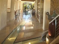 glass flooring is installed over flowing water through this house
