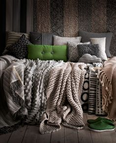One can never have too many blankets and pillows <3  Love the greys and bright green!