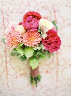 I love this hot pink and coral bouquet! #wedding #inspiration #details #bouquet #flowers #hotpink #pink #coral