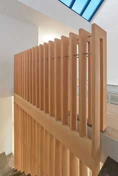 Detail of the douglas fir guardrail at the third floor level. Tagged: Staircase, Stone Tread, and Wood Railing. Atrium Townhome by RobitailleCurtis. Browse inspirational photos of modern staircases. Wood Railing, Wood Stairs, Stair Railing, Wood Architecture, Architecture Details, Montreal, Atrium Design, Wooden Slats, Modern Staircase