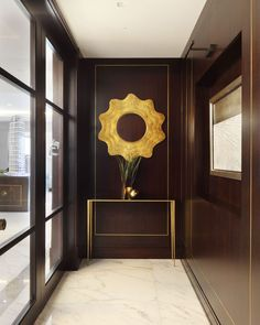 Wood Paneling in Foyer / Entrance . Metal inlays in dark wood by Taylor Howes - works best in tall proportions