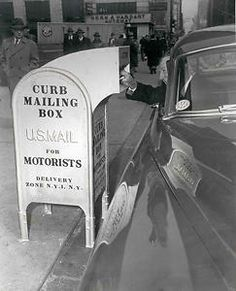 A 1953 photograph of the Post Office Department's new snorkel chute curbside mailbox. The mailboxes were designed to permit motorists to drop off their mail without getting out of their cars. This mailbox was placed in front of New York City's main city post office.