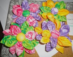 Fabric flowers for my craft board. I linked the tutorial I used. I found it helpful to use a hot glue gun to stabilize the button in the middle.