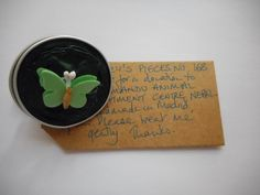 Pillsbury?s Pieces No, 168. Pin - dark green capsule with green paper butterfly. In exchange for a donation to KATHMANDU ANIMAL TREATMENT CENTRE, Nepal. Available at St. George's Church, Madrid on Saturday 13 June from 11.00 - 15.00.
