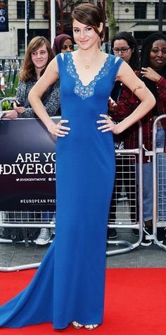 Look of the Day › March 31 2014 Woodley swept the red carpet at the Divergent London premiere in a lace-trimmed azure blue Stella McCartney gown, with her favorite gold pendant and a gold arm cuff for jewelry.