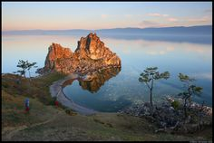 Burkhan Rock or Shaman's Rock or the Shamanka Khuzhir, on Olkhon island (or Olhon island), Lake Baikal, Siberia, Russia - photo by Remo Savisaar;  considered by the indigenous Buryats believe the Olkhon island to be a spiritual place