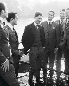 Dapper gents, standing in the river.