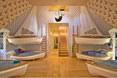 Such a cute nautical little boys room! Boat beds!!! How awesome!