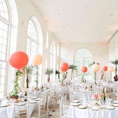 There's so many impressive ways to use balloons in your centrepieces. These ivy clad balloons are being used to carry the table numbers and the added height looks really dramatic in your wedding photos. Ultimate balloon centrepiece inspiration!