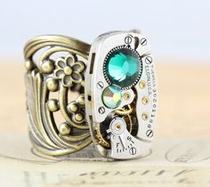 a46d3f99df35 A nice steam-punkish ring with a clock inside and a mint bling stone