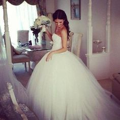tulle wedding dress...Id love this with a little less 'poof'