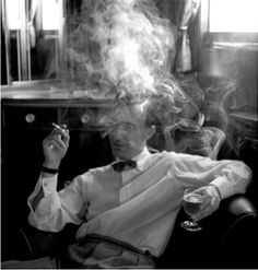 Untitled (Man Drinking and Smoking), 1959. Photo by Vivian Maier.