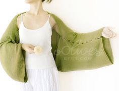 """Cotton Shrug in green with coconut buttons and long sleeves  (58"""" long and about 30"""" wide with 10 buttons per side)"""