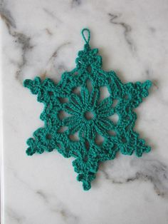"Chain Loop Snowflake By Better Homes and Gardens @Sandy Cobaugh: First of THREE Snowflakes in the ""Crochet a Snowflake Gift Topper"" article. This is the only one with a photo in the article. The other two Snowflakes are: Open Chain Loop Snowflake and Star Snowflake. You will also need a yarn needle and fabric stiffener."