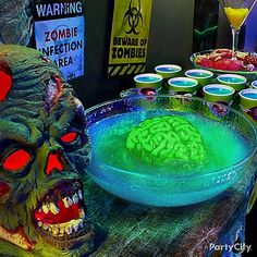 Apocalyptic Brain Punch is the infectious drink of the night! Mountain Dew, a splash of sweet & sour, with a little blue curacao for a radioactive hue is all it takes! A green gelatin brain in the center will add a killer touch!