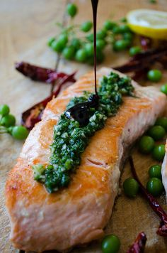 Pan-fried salmon topped with a tangy green sauce and pomegranate molasses. No better combination of flavors on a salmon than this!   giverecipe.com   #salmonrecipes #seafood #greensauce #friedsalmon #healthyrecipes #easyrecipes