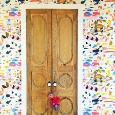 colorful wallpaper and detailed wooden doors!
