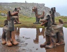 Garden art dogs made from old miner's boots by U.K. artist David Kemp.