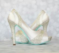 b0c180d84522 Custom Wedding Shoes  White platform peeptoe custom wedding shoes with a  silver crystal covered heel and silver panels and a seafoam blue painted  sole by ...