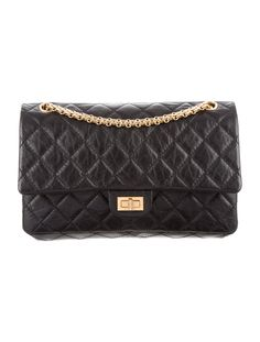 Black quilted leather Chanel Reissue 226 Flap bag with gold-tone hardware, single shoulder strap with chain-link accent, single slit pocket at exterior, single pocket at flap with zip closure, burgundy leather interior, dual interior compartments; one with flap and snap closure, dual slit pockets at interior walls and flap featuring mademoiselle-lock closure at front. Serial number reads 15769118. Includes box and dust bag. Shop authentic designer handbags by Chanel at The RealReal.