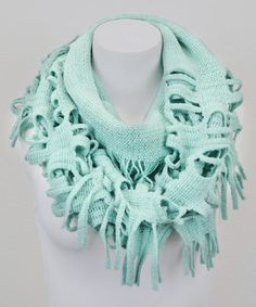 Boisterous tassels liven up this infinity scarf, crafting a deconstructed look that brings a layer of casual-cool to a cool-weather ensemble.