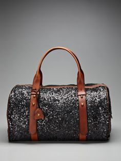 kate spade new york started small: a simple, sleek collection of bags by former accessories editor Kate Brosnahan Spade, who was on a quest to design the perfect handbag. She all but found it, and the line rapidly grew into the essential lifestyle brand it is today. From shoes to stationery, party dresses to (of course) purses, every kate spade new york design celebrates functionality, wit, and playful sophistication. The brand's deliciously feminine sensibility extends to its housewares…