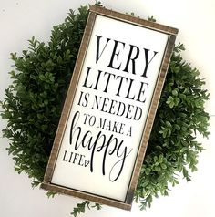 Very Little Is Needed To Make A Happy Life | Family Sign | Farmhouse Sign | Modern Farmhouse | Fixer Upper | Farmhouse Decor | Wedding Gift •Framed wood word sign •White background, black lettering and espresso frame •Measures 8.5 in wide x 18 in tall •Freestanding or hangable