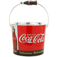 A must have this summer.  A great way to carry drinks to the pool or park.  It features a metal handle with a  replica of a contoured Coca-Cola bottle as a hand grip.