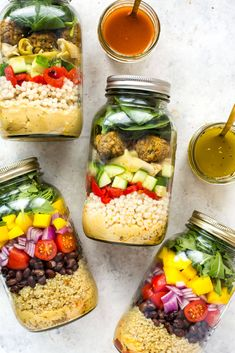 The Ultimate Vegetarian Mason Jar Salad is packed with protein and a delicious hummus base that acts as an extra layer of flavour - try the Mediterranean Falafel version or the BBQ Quinoa version with black beans and diced mangos!