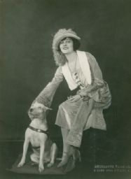 Bull Terrier and lady friend in a dashing hat probably photographed in the late 1800s. I need to dig out my old fashion design books to date her clothes...