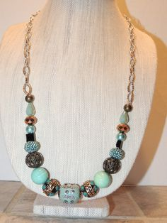 Funky Chunky Turquoise and Silver beaded Necklace with Lamp work beads and silver accents. by GabiLuBoutique on Etsy