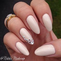 OPI 'My Vampire is Buff' (an almond-y beige nude) + rhinestone accent nail | manicure @nikki_makeup. Midi rings from @luckyeyeslondon #oval nails #bling #nail
