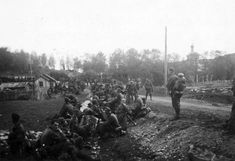 """1941 """"Gebrirgsjäger"""" (mountain troops) Wehrmacht stopped in a village on the eastern front"""