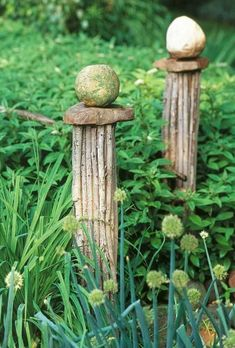 Make these concrete columns and top with rocks, glass balls or ??  Garden Art From Recycled Materials | ... your yard with garden art made from recycled or inexpensive materials