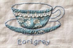 Appliqué and embroidery tea cup would be nice on mug rug.  Click for many others.