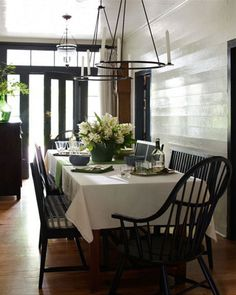 If you want to add black to your kitchen table without painting your table, consider adding just black Windsor chairs. I did this in my last house and the buyers insisted on purchasing the set with the house!