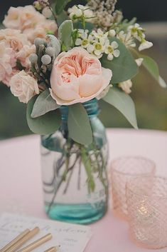 Peach and blush flowers filled in mason jar wedding centerpieces. Here're some creative ways you can utilize the mason jar wedding centerpieces Wedding Centerpieces Mason Jars, Wedding Decorations, Centerpiece Ideas, Pink Flower Centerpieces, Pink Table Decorations, Blush Centerpiece, Quinceanera Centerpieces, Rustic Centerpieces, Flower Decorations