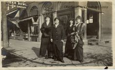 """ID#0382 Date: Unknown. These women are standing on the northeast corner of North Main and East College streets. The sign behind them reads """"Sugar Bowl. Candy-Ice Cream."""" The Sugar Bowl was located in the first floor of the old Oberlin Inn on North Main Street. Participant: H. Scott Broadwell."""