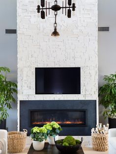 The spacious great room with two inviting sofas, custom designed fireplace and soft, neutral-based textiles offers a comfortable and stylish space for lounging and entertaining.