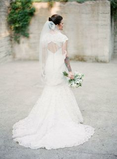 Love the back of this wedding gown: www.StyleMePretty... Photography: Em The Gem on #SMP - http://www.hireevents.co.uk/love-the-back-of-this-wedding-gown-www-stylemepretty-photography-em-the-gem-on-smp/