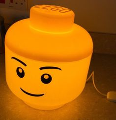 www.LightsInStuff.co.uk  LED Lego Lamp (L) Boy - professionally assembled from Legos popular large storage containers using high quality components. Each product is fitted with a 9W LED Bulb for incredible efficiency and up to 14,000 hours of usage without ever getting hot. All components securely fitted with no access for maximum safety.  The lamp makes the perfect addition to any room with a soft yellow glow and unique aesthetic. Ideal for enthusiasts of any age. Dimensions; (Large Storage…