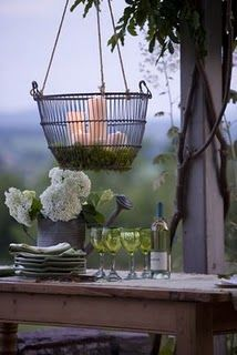 Make this DIY outdoor chandelier with an old metal planter or basket, moss, and candles to add a special touch to your outdoor entertaining area. Outdoor Dining, Outdoor Tables, Outdoor Spaces, Outdoor Decor, Party Outdoor, Outdoor Chandelier, Outdoor Lighting, Hanging Chandelier, Candle Chandelier