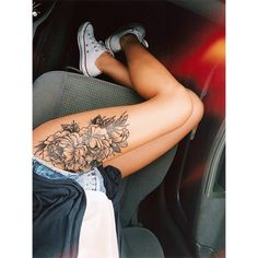 beautiful peony flower thigh tattoo