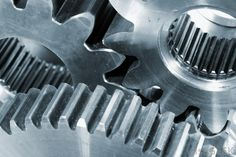 gears, industrial, metal, silver, cold, smooth, meshes tightly together, shiny, turning parts