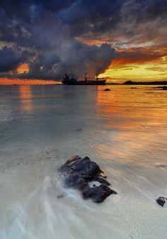 Mystery Ship in Sunrise  by dwi yulianto