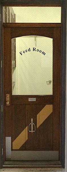 Repurposed door with barn logo in panel. Roseview Dressage- Wellington, Florida - Millbrook, NY.