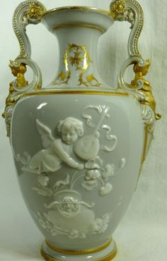 Circa 1860. This Stunning vase features a most enjoyable Cherub/Putti serenading a possible courting couple.