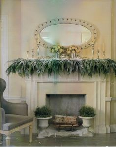 Love the icicles added to the greenery on this snowy mantelscape—Martha Stewart Christmas Decor.