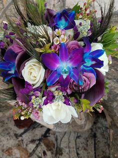 A Peacock Celebration hand tied bridal bouquet